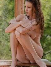 Amber Sym shower outdoors